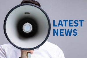Latest News about AIM - man with megaphone